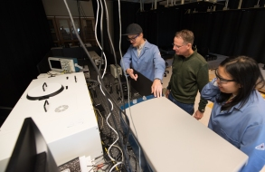 Dr. Schanze and his students working in their two sunlight-harvesting labs