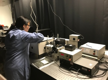 Yajing working the in the laser lab